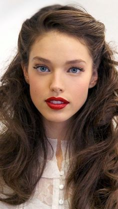 Simple vintage styled hairstyle. We love the red lip!