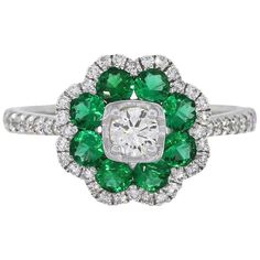 Material: White Gold Round Diamond Details: Approximately of round brilliant diamonds. Diamonds are G/H in color and VS in clarity Emerald Details: Approximately of round cut Emerald gemstones. Size: Total Weight: Measurements: x x SKU: Emerald Gemstone, Brilliant Diamond, Moissanite, Custom Jewelry, Round Diamonds, 18k Gold, Bracelet Watch, White Gold, Gemstones