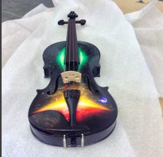 Galaxy Dream Violin, Rozannasviolins, available exclusively through Musiciansfriend, Guitar Center with the sheet music to Star Wars