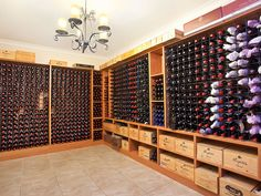 Infinity Style Wine Room with Wooden Wine Crate Shelving