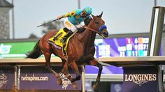 Victor Espinoza rides American Pharoah to win the Breeders Cup Classic at Keeneland Race Track on October 31, 2015