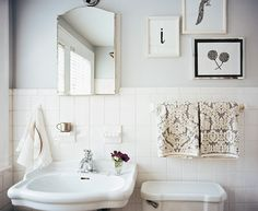 Vintage Bathroom: White tile and gray walls in a bathroom with a pedestal sink.