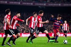 Lionel Messi (R) of FC Barcelona conducts the ball past Inigo Lekue (L), Eneko Boveda (2nd L), Mikel San Jose (C) and Aymeric Laporte (2nd R) during the Copa del Rey Quarter Final Second Leg between FC Barcelona and Athletic Club at Camp Nou stadium on January 27, 2016 in Barcelona