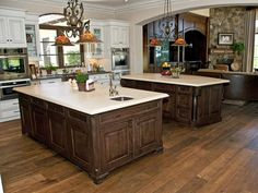Hardwood: Naturally Noteworthy - Hardwood flooring may not be the most water-resistant kitchen flooring choice, but it is a popular and beautiful floor covering. The wide-plank hardwood in this kitchen is made with FSC-certified hardwood and protected with an eco-friendly wax-oil finish.