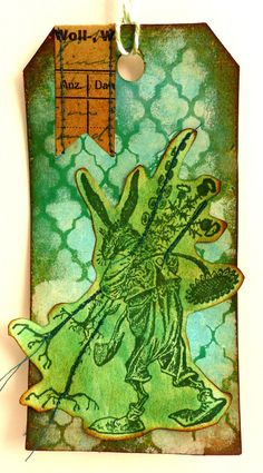 Rubber stamp of a Gardening hare / Easter stamp / by MAKIstamps Gessoed Background sprayed with Distress Stain Spray. The vignette was sewn onto the tag.
