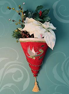 Free project instructions to make a cone-shaped wall hanging.