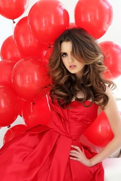 Laura Marano - Are those red hearts or red balloons floating around your stunning shapely cocktail gown, Laura?