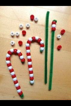 Christmas candy canes. Pipe cleaners and beads: threading