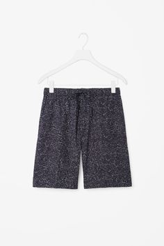 These tailored shorts are made from smooth cotton with an all-over speckled print. A slim leg, they have a zip fly fastening, slanted pockets and a drawstring fastening around the waist.