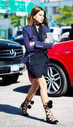Christine Centenera wears a striped blazer, skinny scarf, miniskirt, and lace-up Gucci heels