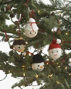 Amigurumi Ornaments for your christmas tree! Make Santa and Mrs. Claus, an angel and a snowman. All crocheted in Lily Sugar'n Cream.