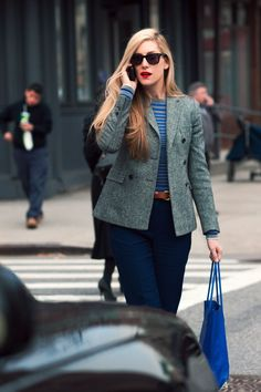 Joanna Hillman in grey blazer and blue pants.