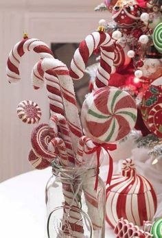 Assorted Peppermint Candy Canes, Lollipops and sprays in a clear jar container - Kitchen Candy