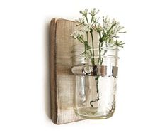 Wall vase using repurposed wood, mason jar and the plumbers version of a zip tie...would be great for candles