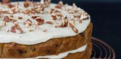 This impressive carrot cake is loaded with sultanas and crunchy pecans, and laced with warming spices and decadent, nutmeg cream cheese icing.
