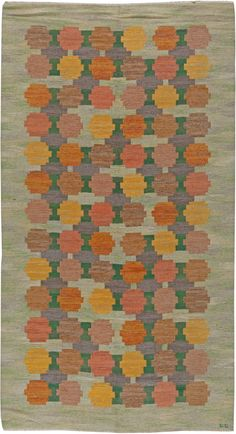 Stylized blooms in warm colors on a green field. It is a typical design by Judith Johanson.
