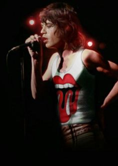 The Rolling Stones: Mick Jagger on stage. - I love when rock stars wear their own band shirts