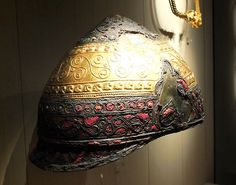 Hayat Archaeology    Celtic helmet of the fourth century BC. Made of bronze, iron, enamel, and gold.