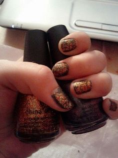 The Hunger Games nail polish. Stone Cold (district 5) and Electrify (district 3). Stone Cold is matte already, but I added a matte top coat to tone-down Electrify. I really like this combo. <3