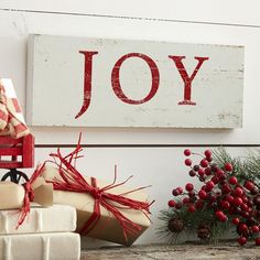 Joy Plaque | Evoke a festive spirit in your space with this seasonal plaque.