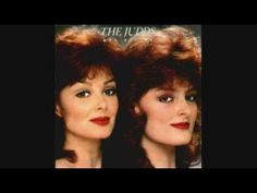 Why Not Me? by The Judds off of their album Why Not Me    Enjoy!!!!!!      DL Link:  http://www.ziddu.com/download/7429938/WhyNotMe.wma.html          Lyrics:    You been lookin' for love all around the world  Baby don't you know this country girls still free  Why not me?    So you finally come down to your old home town  Your Kentucky girls been...
