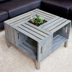 Paint old crates and assemble them into a coffee table with storage.