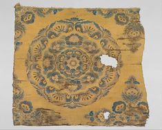 Textile with Floral Medallion Period: Tang dynasty (618–907) Date: late 8th–early 9th century Culture: China Medium: Weft-faced compound twill Dimensions: Overall: 24 x 28 in. (61 x 71.1 cm) Mount (with plexi cover): 28 3/4 x 32 1/2 in. (73 x 82.6 cm) Classification: Textiles-Woven