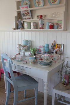 Transform an old desk with fresh paint and adorn it with pretty vintage china and other collectables.