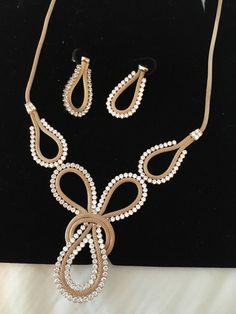 A personal favorite from my Etsy shop https://www.etsy.com/listing/479960483/14k-gold-kocak-glorious-lavaliere-knot