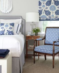 Matching curtain and throw pillow fabric and coordinating chair upholstery create a beautiful, unified bedroom