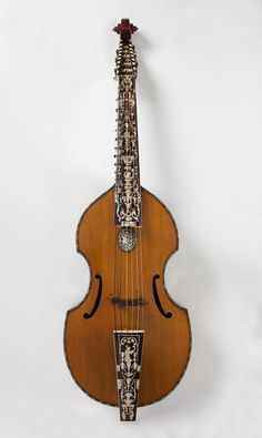 """BASS VIOL - *1700 German (Hamburg) Bass viol at the Victoria and Albert Museum, London -: """"Viols were bowed instruments ranging from treble to bass, but by about 1780 they had been superceded by the violin and cello. However, this bass viol belonged to John Cawse (1779-1862), one of the earliest pioneers in the revival of Early Music. The body may have been made by Joachim Tielke (1641-1719), but the neck, fingerboard and tailpiece date from the mid 1720s."""""""