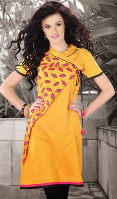 Designer Yellow Dupioni Raw Silk Kurti An outstanding designer yellow dupioni raw silk kurti designed with dangler and resham work.  #OnlineIndianSilkTunics #PlusSizeKurtiTunics