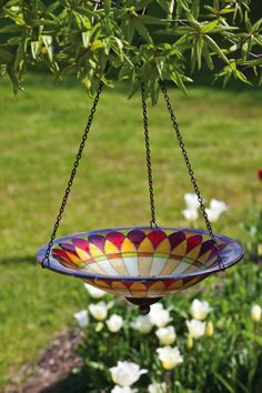 This hanging bird bath offers a beautiful spot for birds to drink and clean their feathers. This glass bird bath bowl has a purple pink and yellow Tiffany inspired petal design. The glass bowl hangs from the included metal chain and can be brought inside Bird Bath Bowl, Glass Bird Bath, Glass Birds, Bird Bath Garden, Diy Bird Bath, Garden Art, Garden Crafts, Dream Garden, Garden Design