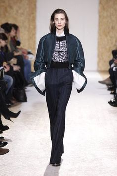 Maison Martin Margiela Autumn-Winter 2013 Womenswear. Cropped bomber jacket - Embroidered sweater - Shirt - Large trousers - Derby shoes with transparent heel.