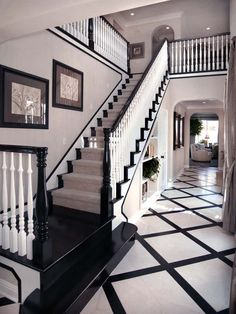 Black painted handrail, baseboards, risers and treads. Classic stair runner design.