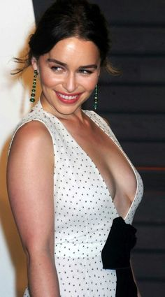 Emilia Clarke flirty candid smile in a shoulderless polka dot dress with a deep plunging neckline braless and messy updo hairstyle, star of Game of Thrones as Daenerys Targaryen, Terminator Genisys, and Me Before You. Emilia Clarke Hot, Emelia Clarke, Beautiful Celebrities, Beautiful Actresses, Most Beautiful Women, Hottest Female Celebrities, Hollywood, Famous Women, Female Form