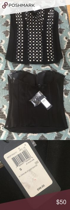 NWT Guess studded black  bustier NWT black Guess studded corset top.  Has a side zipper for closure.  Has silver colored studs.  Comes with removable straps. In 5th pic closet strap for hanging is broken.  But doesn't affect the wear of the top.  It still has its removable straps. Guess Tops
