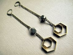 Honeycomb Geometric Earrings: Brass hexagons and natural pyrite (fools gold) nuggets dangle on aged brass chain. 4 long. These striking primal adornments are the perfect bold statement to compliment any tribal, bohemian, gypsy or festival attire! This listing is for a made to order pair of the above pictured earrings. Please allow 1-2 weeks for production.  For other styles and colors, check out my dangle earring section: https://www.etsy.com/shop/Chrysalism?section_id&#x3...