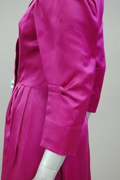 A rare Schiaparelli couture shocking pink coat-dress, late 1930s-early 1940s.  Love those vertical released elbow pleats!