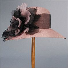 Who needs many clothes when one has hats like this? By Louise Green.