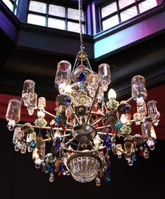 An amazing chandelier made of perfume bottles from Madeleine Boulesteix Chandeliers
