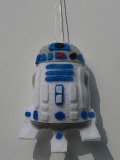 Let the force be with you. This R2D2 ornament is perfect for any Star Wars lover's Christmas tree. This R2D2 ornament is hand cut, hand sewn, and assembled using hot glue. It is made out of felt and measures approximately 5 inches tall and 3 inches across. This R2D2 ornament has hand sewn features that will make this ornament shine on any Star Wars lovers tree. I make several other Star Wars that can be found in my shop. This listing is for one R2D2 ornament.