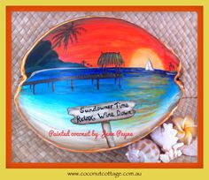 "Painted coconut by Jenn entitled  ""Sundowner Time, relax, wine down!"""