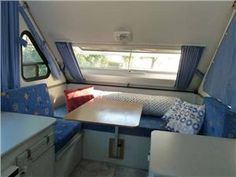 Soft and peaceful interior dining area in this A-Frame folding camp trailer