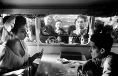 July 1961    Playing cards with photographer Pierluigi in her trailer while fans wait outside during location filming of 'Madame Sans Gene '.    Photographed by Alfred Eisenstaedt for LIFE Magazine.