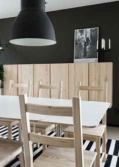an Ikea Hektar lamp, Ivar storage units as a floating credenza and a Stockholm rug in an on-trend Scandinavian dining room. Home Design Decor, House Design, Home Decor, Ikea Inspiration, Dining Room Inspiration, Ikea Interior, Interior Design Kitchen, Piece A Vivre, Scandinavian Home