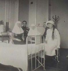 Grand Duchesses Olga, Tatiana and Anastasia Nikolaevna Romanova of Russia in 1915 at Tsarskoe Selo ( translated as Imperial Village )Infirmary.