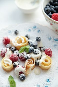 Delicious crepe pappardelle with berries and mint. The husband requests these all the time.