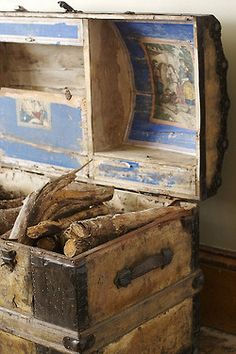Fireplace wood in an old trunk