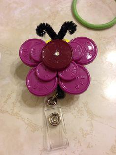 New twist on medication vial top badge holder